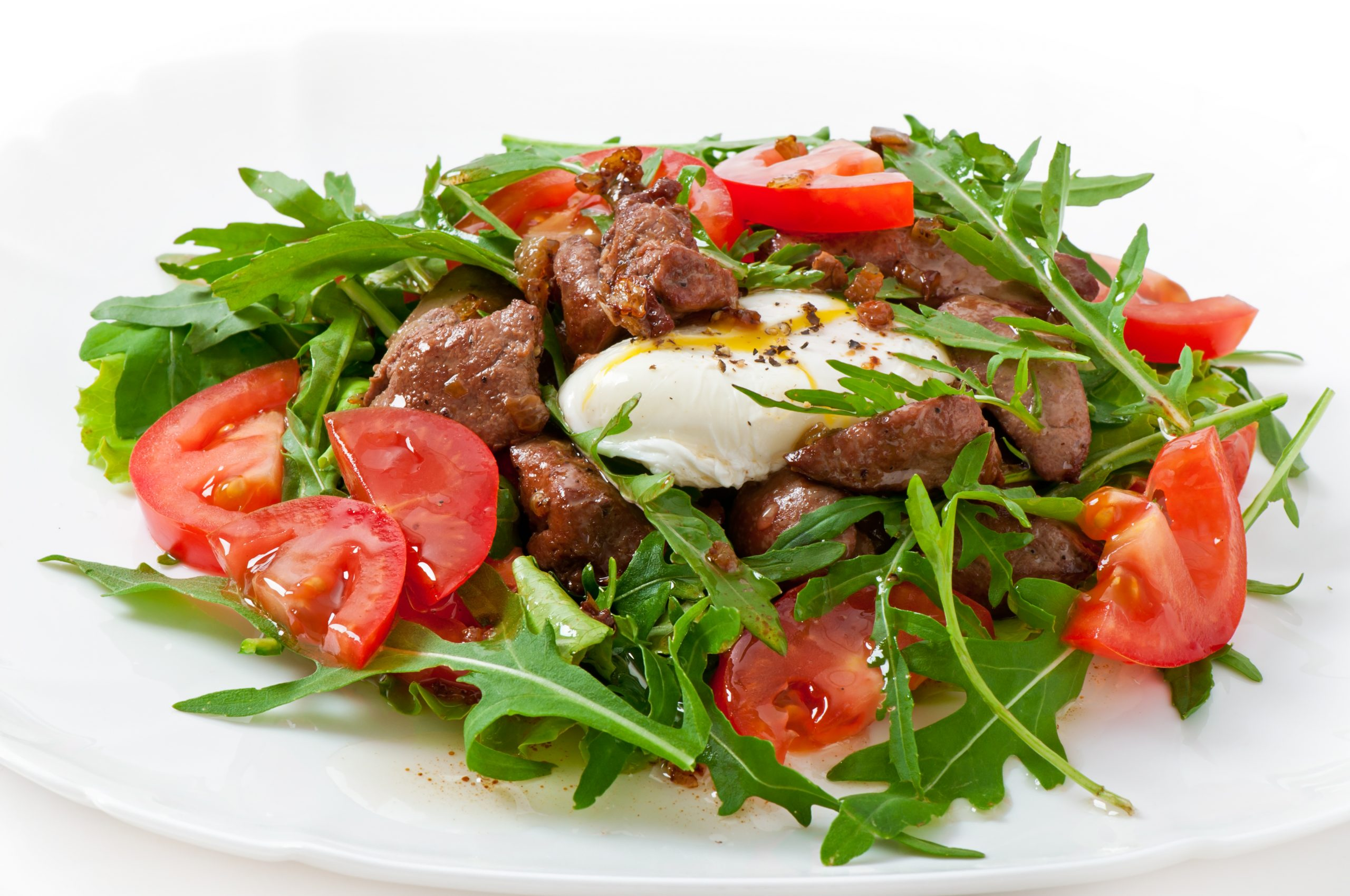 Mixed salad with chicken liver and egg Pochet